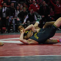 Nebraska's Chad Red Jr. holds Michigan's Cole Mattin in a cradle on the way to winning pinfall in their 141-pound match Friday at the Devaney Sports Center.