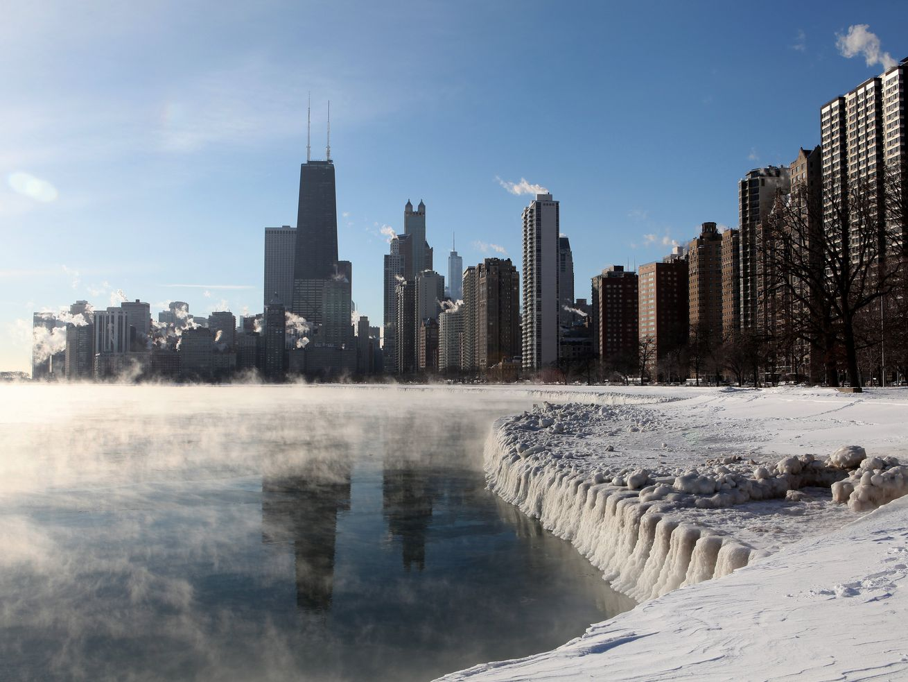 """The Chicago Skyline in 2014 as steam rises from Lake Michigan due to a """"polar vortex"""" event."""