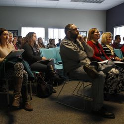 Volunteers watch a documentary about refugees in Utah during a volunteer open house event at the Utah Refugee Education and Training Center in Salt Lake City, Saturday, Jan. 9, 2016.