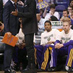Los Angeles Lakers' Kobe Bryant, right, talks with assistant coach Quinn Snyder during the second half of an NBA basketball game against the Phoneix Suns, Saturday, April 7, 2012, in Phoenix.