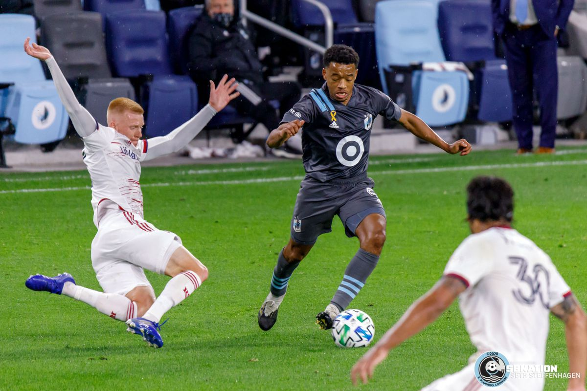 September 27, 2020 - Saint Paul, Minnesota, United States - Real Salt Lake defender Justen Glad (15) goes in for a slide tackle on Minnesota United defender Jacori Hayes (5) during the match at Allianz Field.