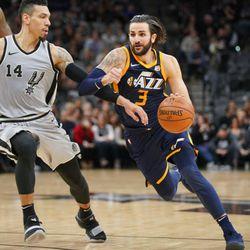 Utah Jazz' Ricky Rubio (3) drives against San Antonio Spurs' Danny Green during the second half of an NBA basketball game, Saturday, Feb. 3, 2018, in San Antonio. Utah won 120-111. (AP Photo/Darren Abate)