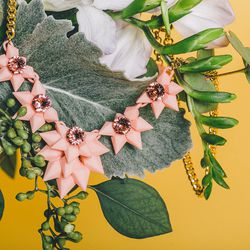 """Ebony Fleur blush 'Reverie' necklace, $129 at In Support Of (call 646-657-0724 for info); <a href=""""https://www.sprouthome.com/"""">Sprout Home</a> arrangement (call 718-388-4440 for info)"""