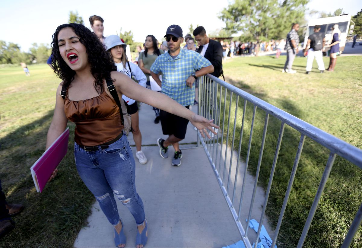 """Irlanda Escobar sings while waiting in line for """"American Idol"""" auditions outside the Northwest Community Center in Salt Lake City on Thursday, Aug. 29, 2019."""