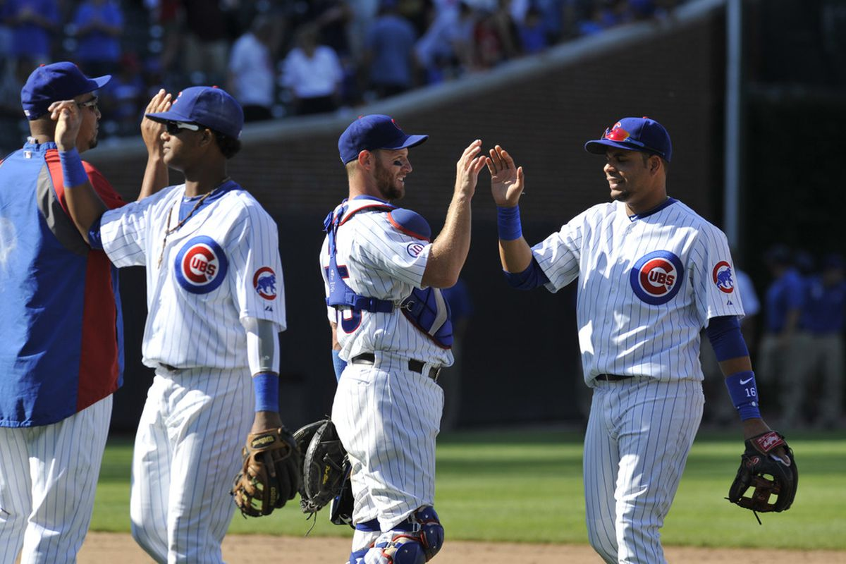 The  Chicago Cubs celebrate their victory over the Washington Nationals at Wrigley Field in Chicago, Illinois. The Cubs defeated the Nationals 4-3.  (Photo by David Banks/Getty Images)