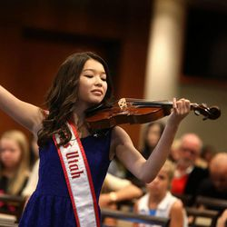 Erika Dalton,13, of Cedar Hills, makes a grand finish after playing the national anthem on her violin during tryouts at EnergySolutions Arena on Friday, Oct. 4, 2013. The winners will perform the anthem prior to each Utah Jazz home game during the 2013-2014 season.