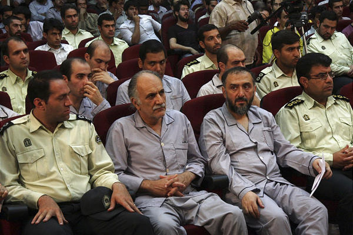 In this Aug. 1, 2009 file photo released by the semi-official Iranian Fars News Agency, former vice president Mohammad Ali Abtahi, second from right, is seen with other defendants in a court room in Tehran, Iran. The wife of Abtahi said Monday her husband