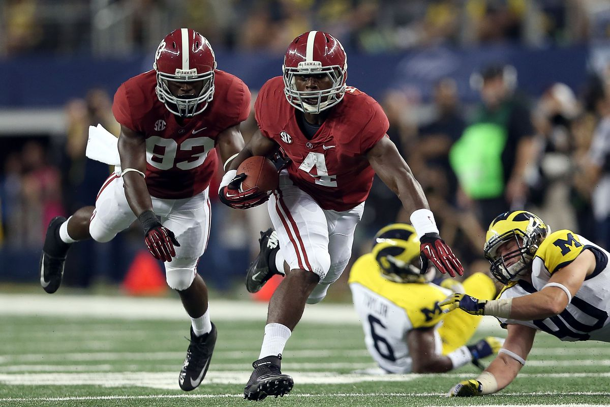 ARLINGTON, TX - SEPTEMBER 01:  T.J. Yeldon #4 of the Alabama Crimson Tide runs the ball against Jake Ryan #90 of the Michigan Wolverines at Cowboys Stadium on September 1, 2012 in Arlington, Texas.  (Photo by Ronald Martinez/Getty Images)