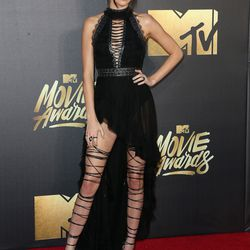 Kendall Jenner wears a Kristian Aadnevik dress and DSquared2 shoes (which, fun fact, took an entire team to lace up).