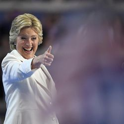 Democratic presidential nominee Hillary Clinton give a thumbs up after taking the stage to make her acceptance speech during the final day of the Democratic National Convention in Philadelphia on Thursday, July 28, 2016.