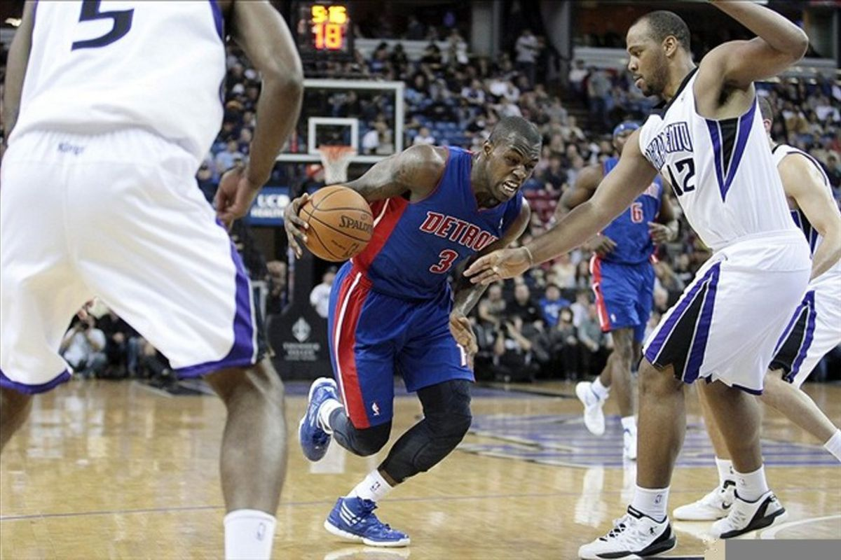 March 14, 2012; Sacramento, CA, USA; Detroit Pistons point guard Rodney Stuckey (3) drives in against Sacramento Kings center Chuck Hayes (42) during the second quarter at Power Balance Pavilion. Mandatory Credit: Kelley L Cox-US PRESSWIRE