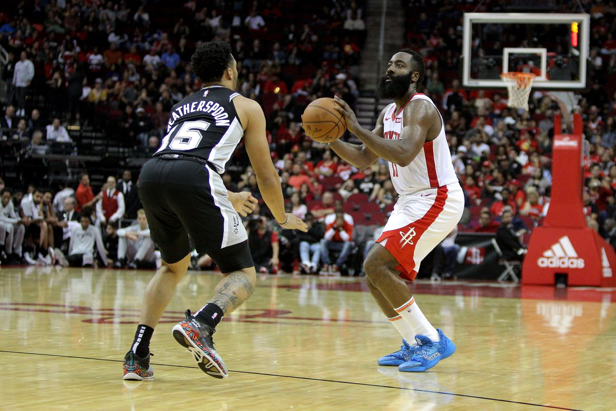 Houston Rockets guard James Harden takes an inside shot while San Antonio Spurs guard Quinndary Weatherspoon defends during the fourth quarter at Toyota Center.
