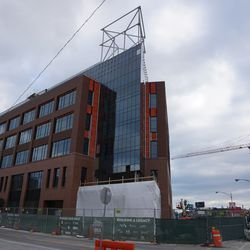 The north side of the plaza building, with the Hotel Zachary tower crane visible in the background