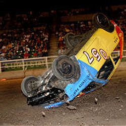 Johnny Vine of team Vibrate rolls his car while competing in the rollover competition on the final day of the Utah State Fair in Salt Lake City on Sunday.