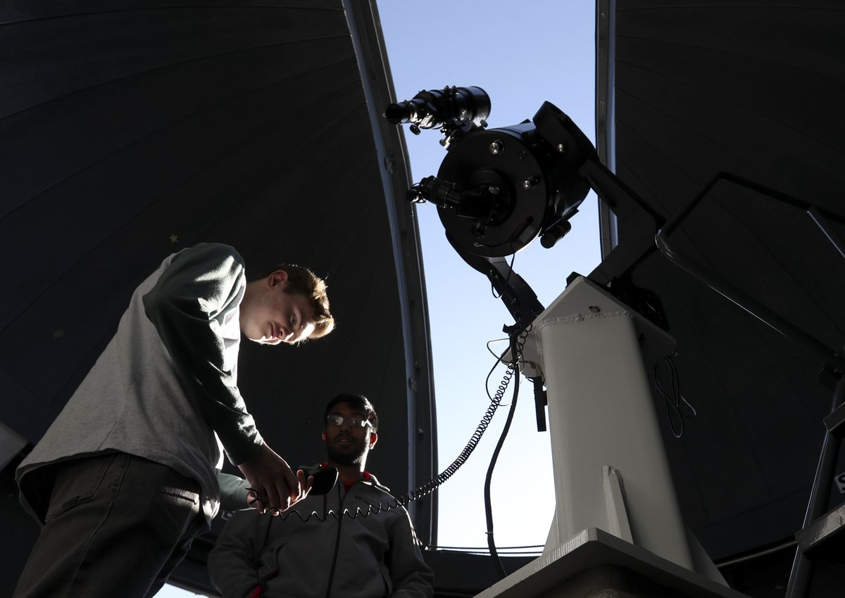 Ian Bokovoy, who attends high school at the Beehive Science & Technology Academy in Sandy, learns how to focus the large telescope on the rooftop of the South Physics Observatory during the University of Utah's 31st annual Science Day at the campus in Salt Lake City on Saturday, Nov. 2, 2019.