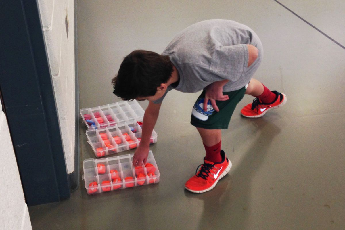 A student at Falcon Bluffs Middle School in Jefferson County picks up his pedometer before P.E. class.