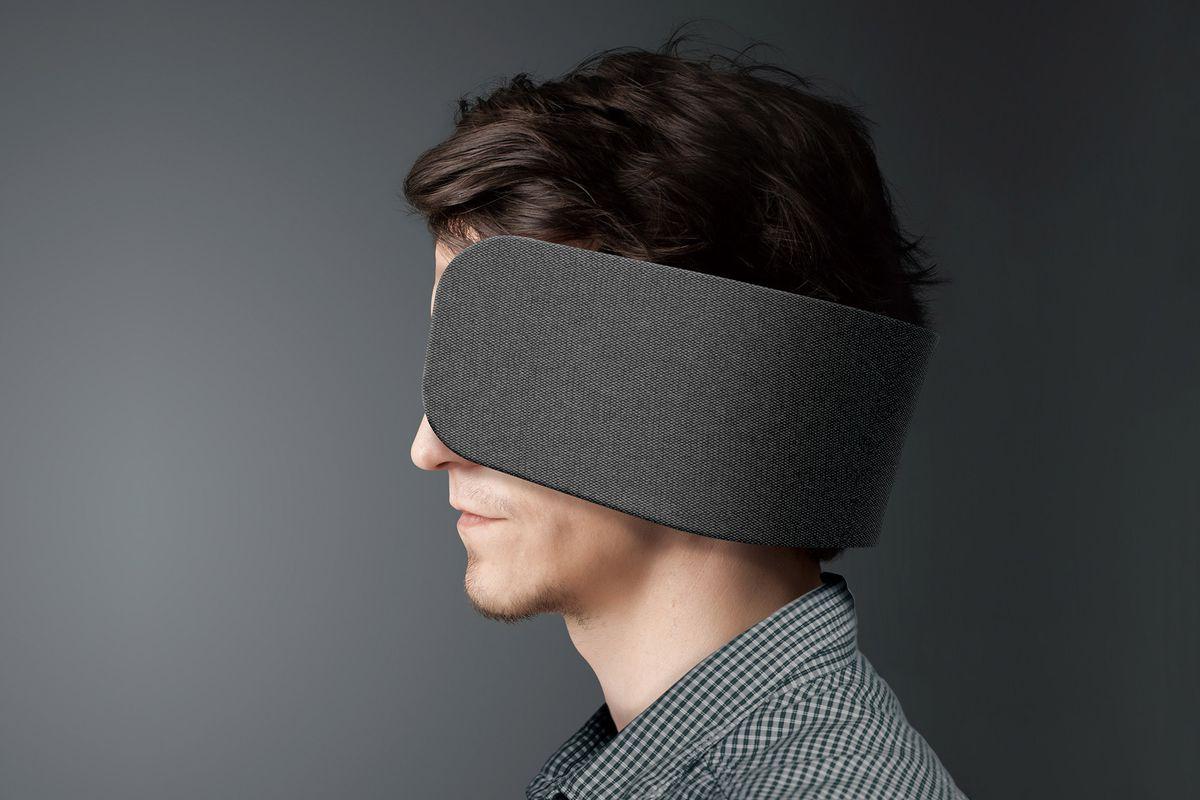 Man wearing piece of fabric around his head