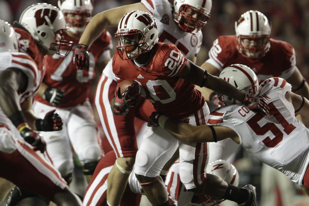 MADISON, WI - OCTOBER 1: James White #20 of the Wisconsin Badgers rushes past Brandon Chapek #51 of the Nebraska Cornhuskers October 1, 2011 at Camp Randall Stadium in Madison, Wisconsin.  (Photo by John Gress/Getty Images)
