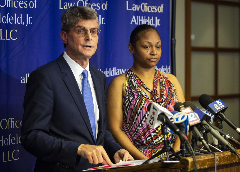 Krystal Archie looks on as her attorney, Al Hofeld, Jr., speaks about Chicago Police executing three search warrants in four months at her South Side home, during a press conference at Hofeld's law offices in the Loop, Friday morning, July 19, 2019.