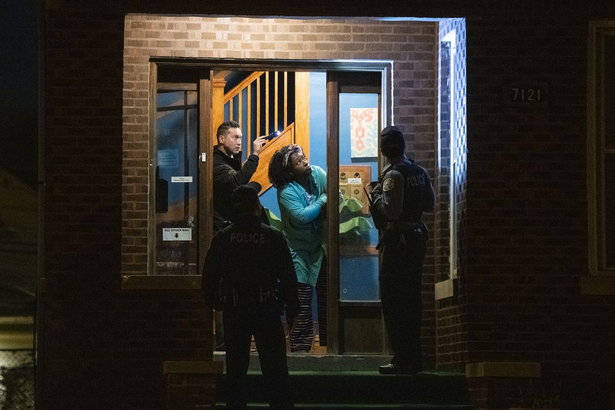 Chicago police investigate a man shot while leaving his home Monday night in the 7100 block of South Campbell. | Tyler LaRiviere/Sun-Times
