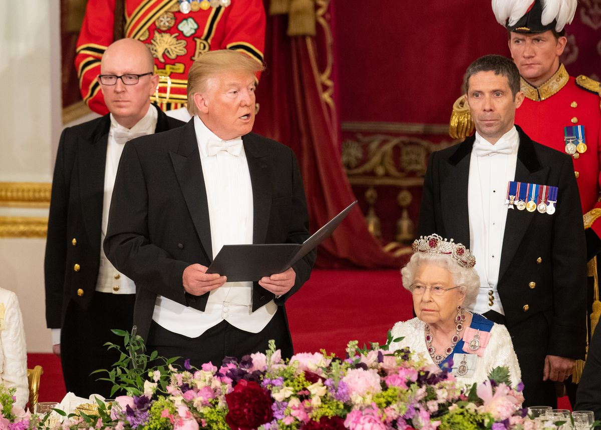 President Donald Trump makes a speech as Queen Elizabeth II listens during a state banquet at Buckingham Palace on June 3, 2019, in London, England.