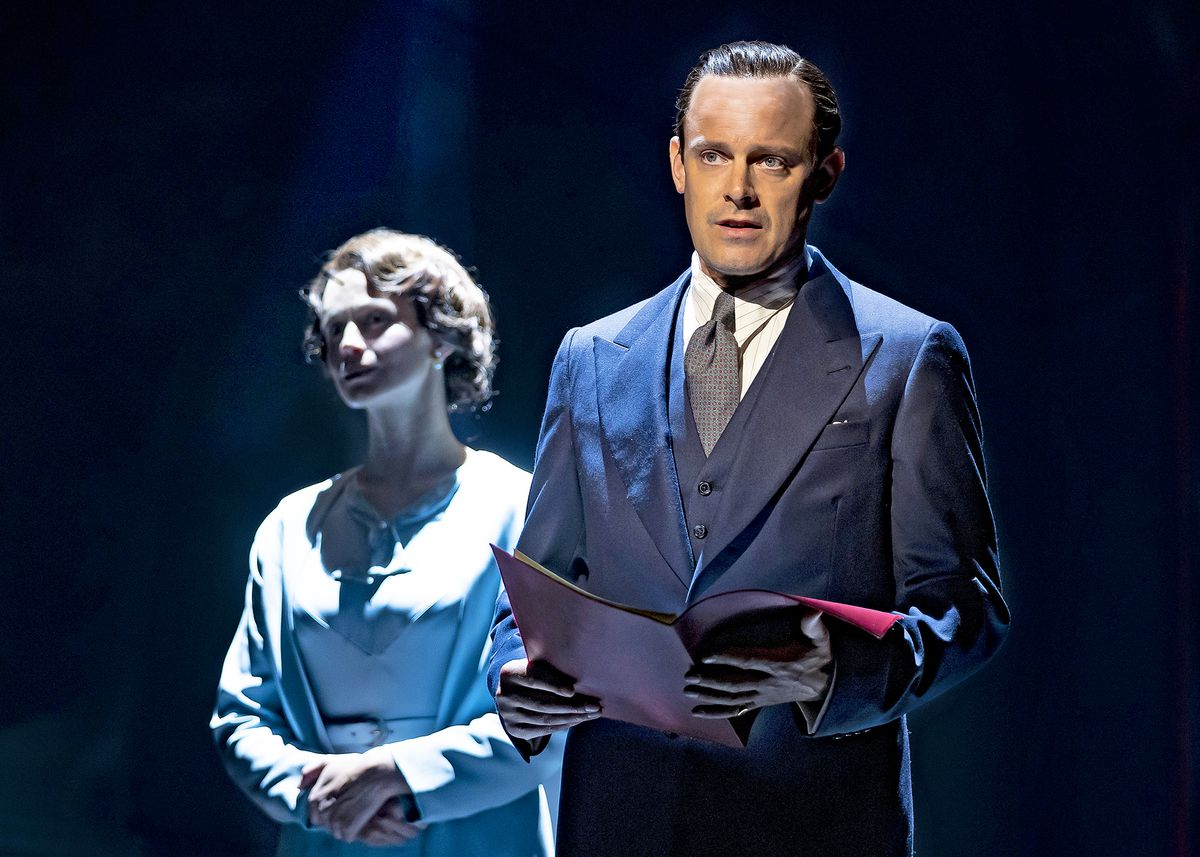 """Bertie (HarryHadden-Paton, right) prepares to address the nation, as his wife Elizabeth (RebeccaNight) stands by reassuringly in Chicago Shakespeare's production of """"TheKing'sSpeech,"""" directed by MichaelWilson."""