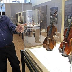 In a Monday, April 9, 2012 photo, Violin maker Amnon Weinstein talks about the stories behind the Violins of Hope exhibit at UNC Charlotte in Charlotte, N.C., Monday, April 9, 2012. Eighteen violins recovered from the Holocaust and restored by Weinsten make their U.S. debut on Sunday, April 15. Some were played by Jewish prisoners in Nazi concentration camps, while others belonged to the Jewish Klezmer musical culture. (AP Photo/Chuck Burton)