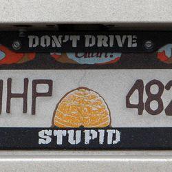 License plate and bracket on the car of Utah Highway Patrol trooper Carlos Holley on Thursday, Dec. 13, 2012.