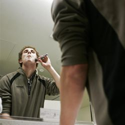 Eric Richardson shaves in a bathroom in the library before finding a place to study. He chose a particular bathroom in the library because it had the biggest counter.