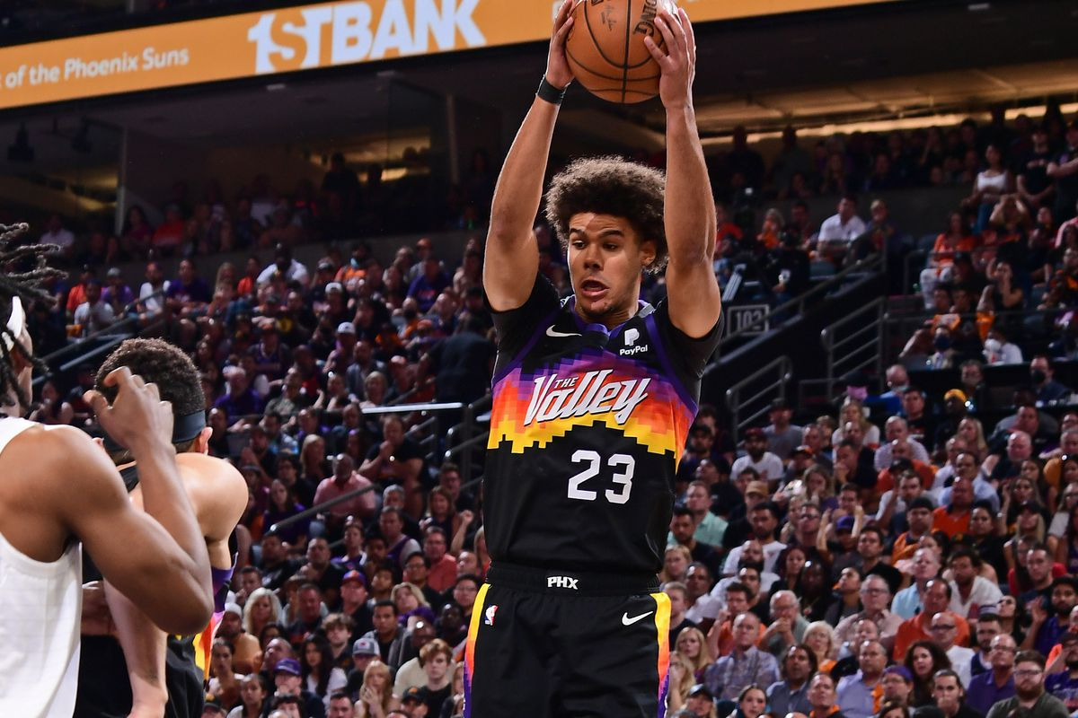 Cameron Johnson #23 of the Phoenix Suns rebounds the ball during Game 5 of the Western Conference Finals of the 2021 NBA Playoffs on June 28, 2021 at Phoenix Suns Arena in Phoenix, Arizona.