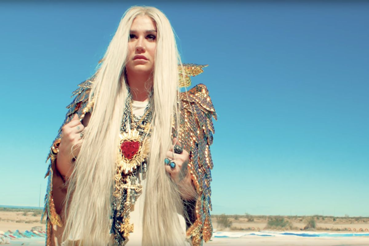 """Kesha wears an Amato Couture outfit and jewelry by Gasoline Glamour and Roseark in her """"Praying"""" music video."""