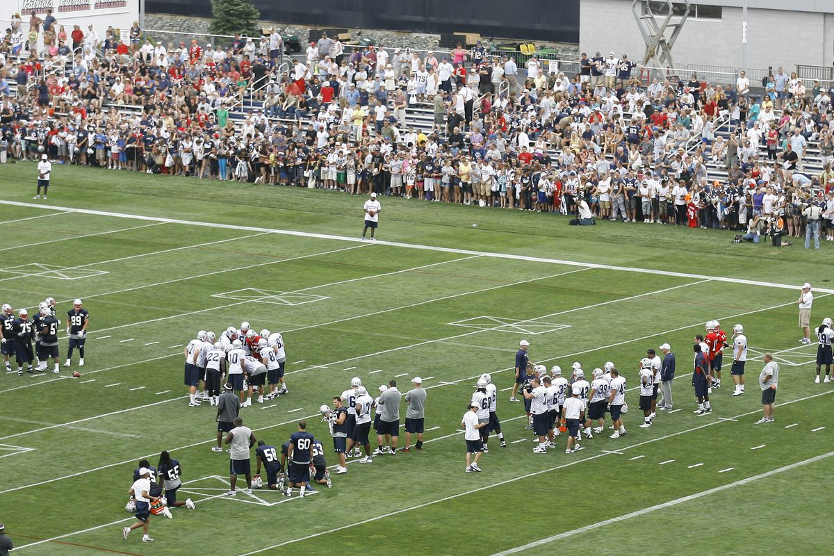 July 27, 2012; Foxborough, MA, USA; The New England Patriots practice as fans watch during training camp at the team practice facility. Mandatory Credit: Stew Milne-US PRESSWIRE