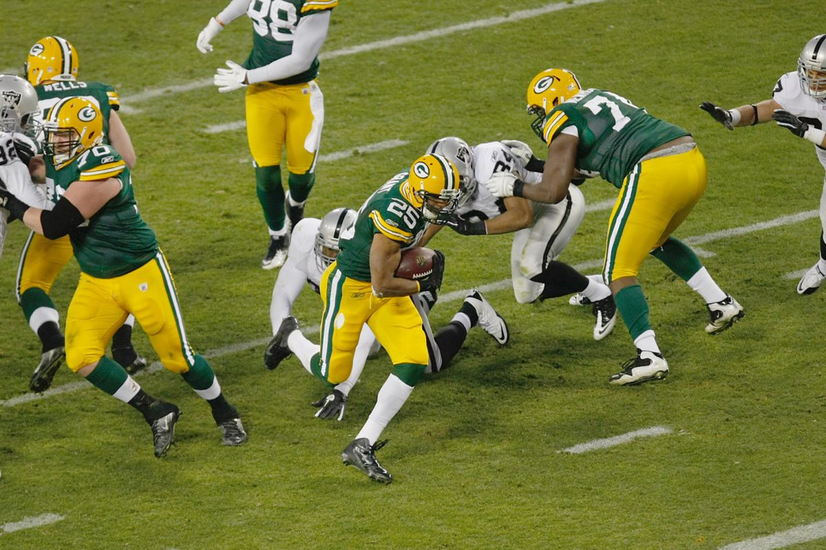 GREEN BAY, WI - DECEMBER 11: Ryan Grant #25 of the Green Bay Packers runs for a touchdown during the game against the Oakland Raiders at Lambeau Field on December 11, 2011 in Green Bay, Wisconsin. (Photo by Scott Boehm/Getty Images)