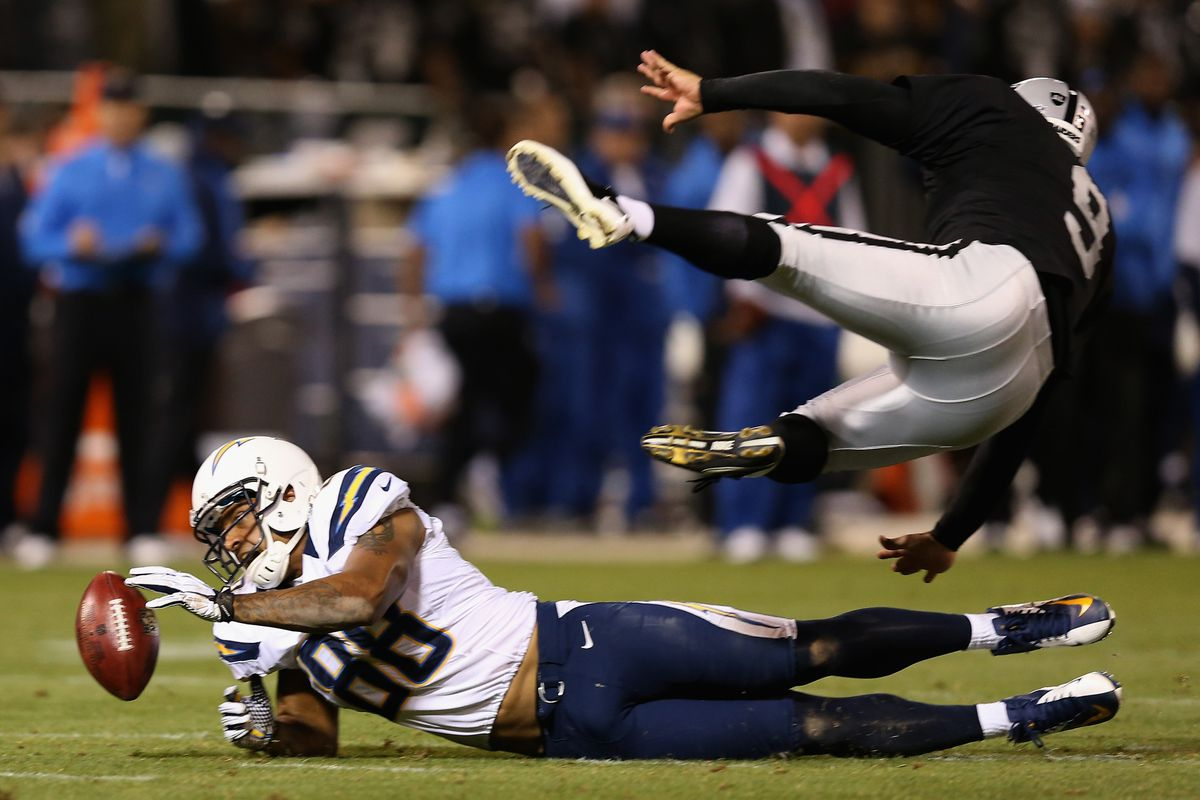 Dante Rosario #88 of the San Diego Chargers blocks a punt attempt by Shane Lechler #9 of the Oakland Raiders during their season opener