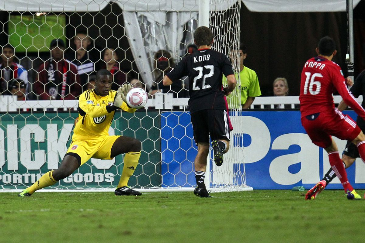 WASHINGTON, DC - OCTOBER 15: Bill Hamid #28 of D.C. United saves a shot against Marco Pappa #16 of Chicago Fire at RFK Stadium on October 15, 2011 in Washington, DC. (Photo by Ned Dishman/Getty Images)