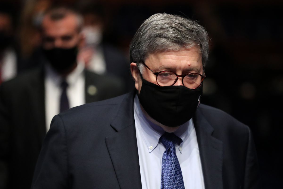 US Attorney General Bill Barr wears a face mask as he arrives from a break in his testimony to the House Judiciary Committee in the Congressional Auditorium at the Capitol Visitors Center on July 28, 2020, in Washington, DC.