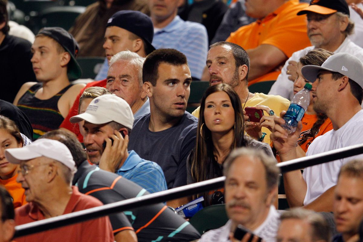 BALTIMORE, MD - MAY 22:  Baltimore Ravens quarterback Joe Flacco (C) watches the Baltimore Orioles and Boston Red Sox game at Oriole Park at Camden Yards on May 22, 2012 in Baltimore, Maryland.  (Photo by Rob Carr/Getty Images)