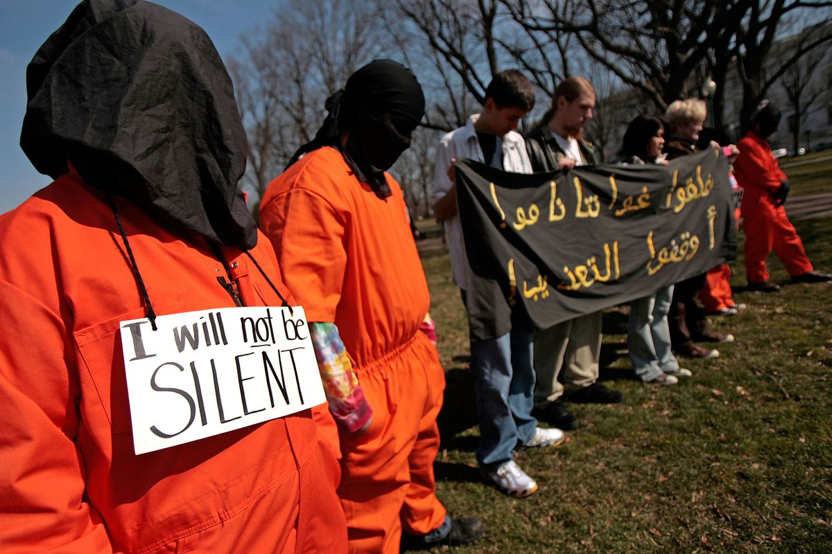 Members and supporters of The Washington Region Religious Campaign Against Torture dress as detainees during a rally to 'demand Congressional action to stop torture' on Capitol Hill March 10, 2008 in Washington, DC.