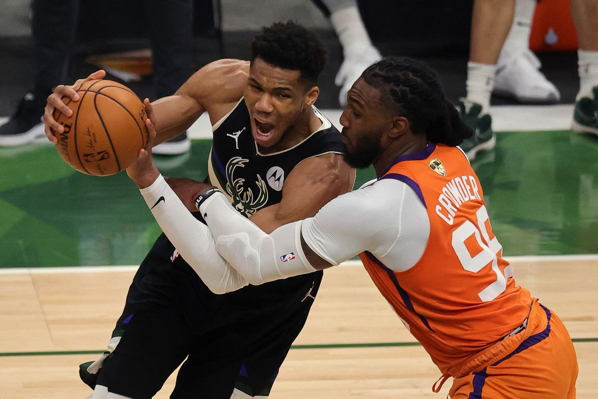Giannis Antetokounmpo drives to the basket against Jae Crowder during Game 6 of the NBA Finals on Tuesday at Fiserv Forum in Milwaukee.