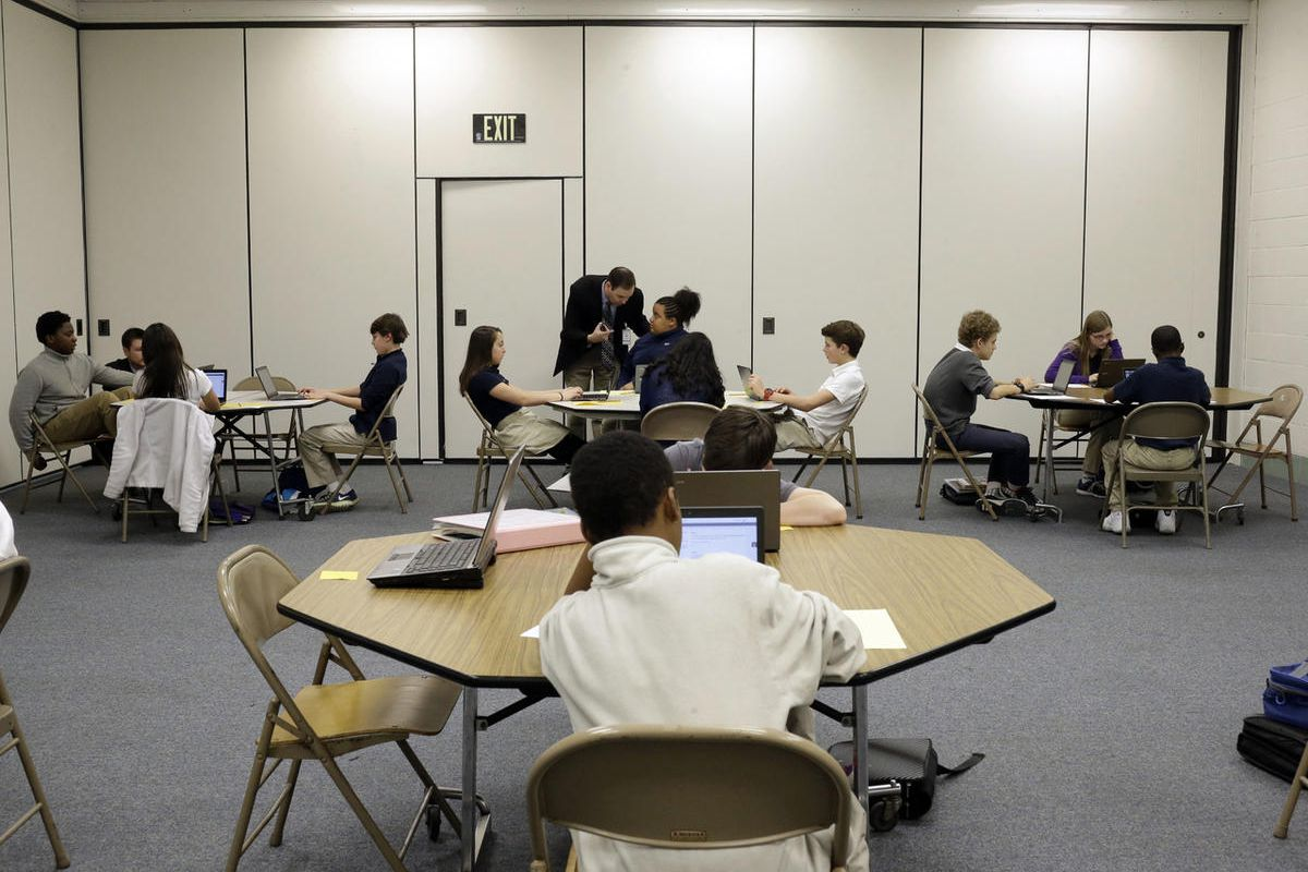 In this Feb. 12, 2015 file photo, seventh-grade students take part in a trial run of a new state assessment test on laptop computers at Annapolis Middle School in Annapolis, Md.