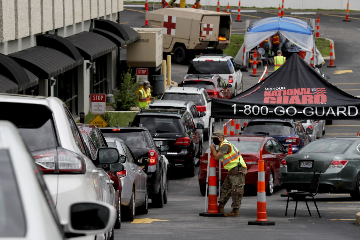 Cars line up outside a drive-through COVID-19 testing site set up by the Missouri Department of Health and Senior Services and operated by the Missouri National Guard, Thursday, May 28, 2020, in St. Charles, Mo.