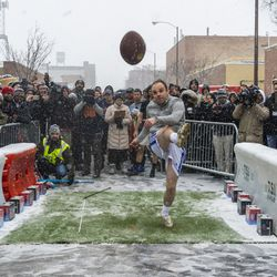 A man attempts to kick a football 43 yards to win NFL tickets to any game outside Goose Islands Tap House, Saturday, Jan. 12, 2019, in Chicago. Goose Island sponsored the event encouraging participants to attempt a similar field goal that Chicago Bears Kicker Corey Parkey missed in a playoff game against the Philadelphia Eagles which resulted in the Bears losing the game.   Tyler LaRiviere/Sun-Times