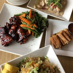 Pancit (noodles), Bicol Express (seafood and pork in coconut sauce), Lumpia (egg rolls) and barbecue chicken at Isla Pilipina Restaurant.| Ji Suk Yi/Sun-Times