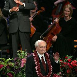 Broadcaster Mike Wallace, top, reacts as President Gordon B. Hinckley greets him and his wife at the finale of A Celebration of Life tribute to President Hinckley Friday, July 22, 2005.  The event marked President Hinckley's 95th birthday and featured performances by Donny Osmond, Gladys Knight and Wallace.