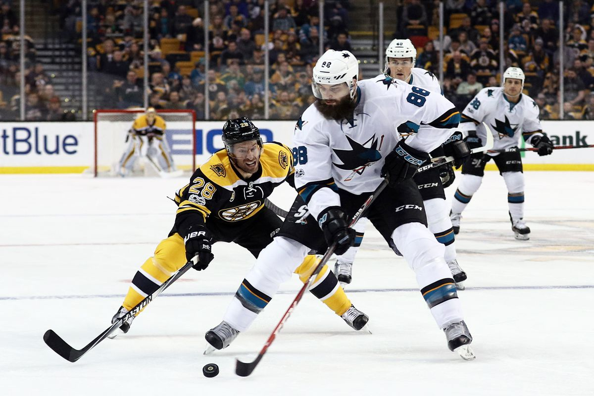 BOSTON, MA - FEBRUARY 9: Dominic Moore #28 of the Boston Bruins defends Brent Burns #88 of the San Jose Sharks during the first period at TD Garden on February 9, 2017 in Boston, Massachusetts.