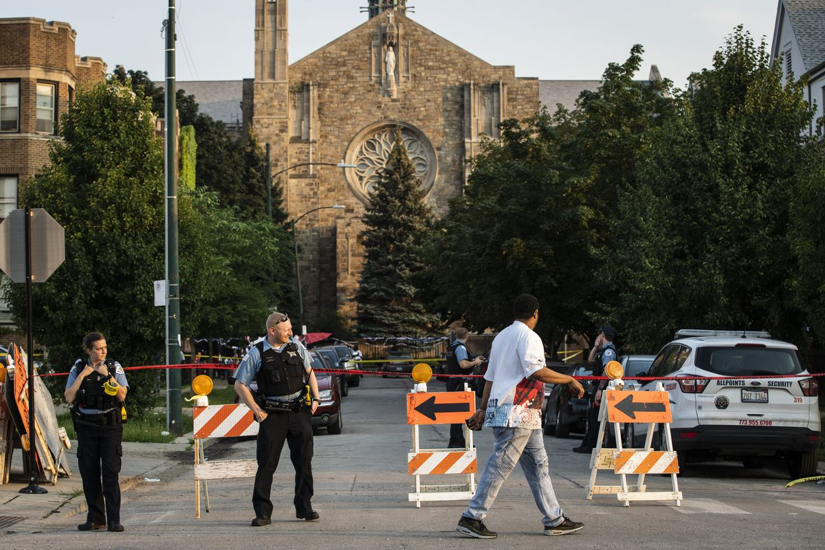 Chicago police investigate Wednesday evening in the 2100 block of East 71st Street in South Shore, where three men were shot and wounded.