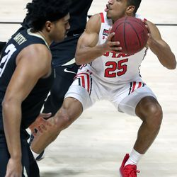 Utah Utes guard Alfonso Plummer (25) looks to shoot during a men's basketball game against the Colorado Buffaloes at the Huntsman Center in Salt Lake City on Monday, Jan. 11, 2021. Utah lost 58-65.