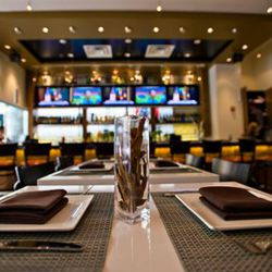 Flat-screen TVs welcome people to relax at the bar