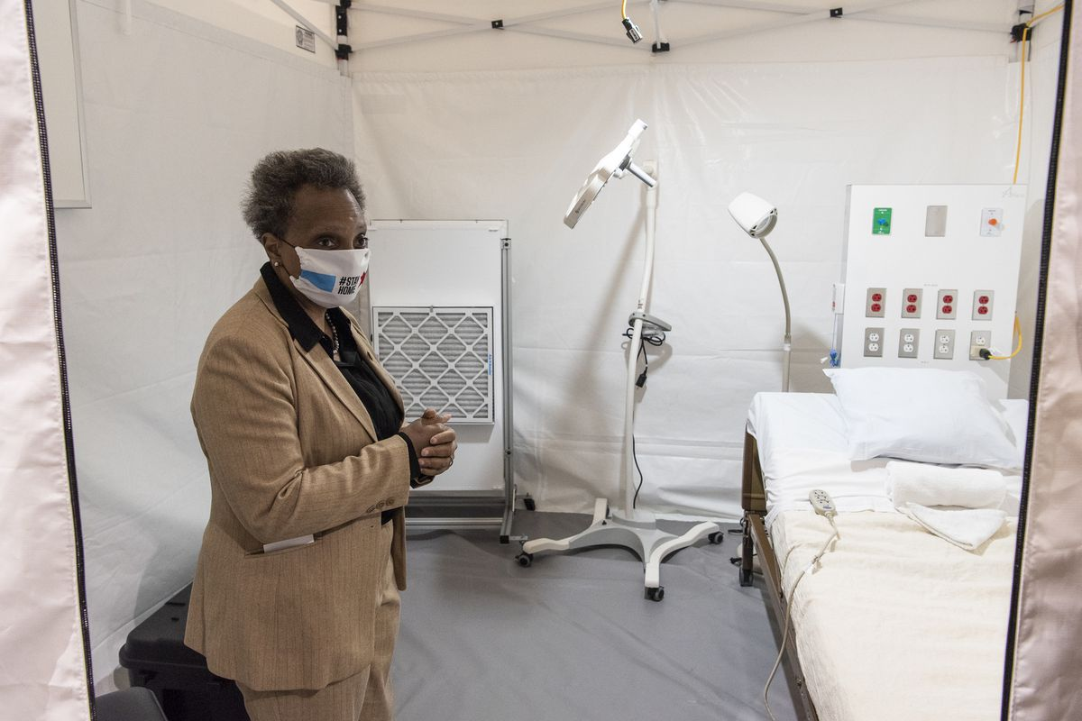 Mayor Lori Lightfoot tours one of the patient rooms at the COVID-19 field hospital at McCormick Place on Friday.