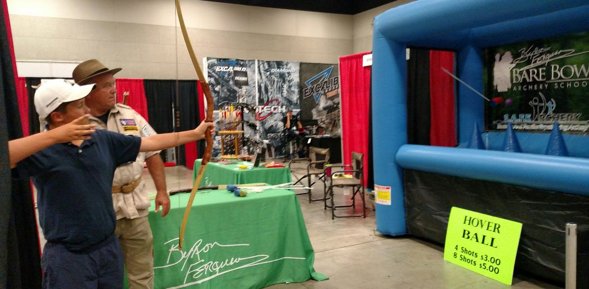 Carter Stevenson shoots at Hover Ball during the Illinois Deer &amp; Turkey Expo at Peoria Civic Center.<br>Credit: Dale Bowman